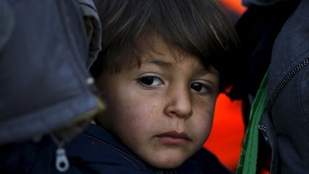A Syrian refugee boy is seen shortly after arriving on the Greek island of Lesbos last week. Vaccinations and dental care are among the priorities for Canadian health-care professionals treating Syrian refugees.