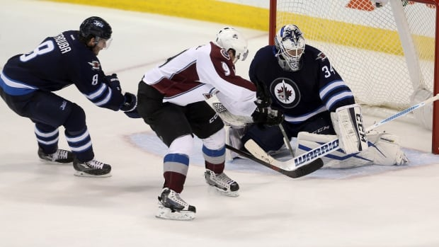 Jets' Jacob Trouba (8) is unable to stop Colorado Avalanche's Matt Duchene (9) as he scores on goaltender Michael Hutchinson (34) during third period NHL hockey action in Winnipeg Monday, Nov. 23, 2015.
