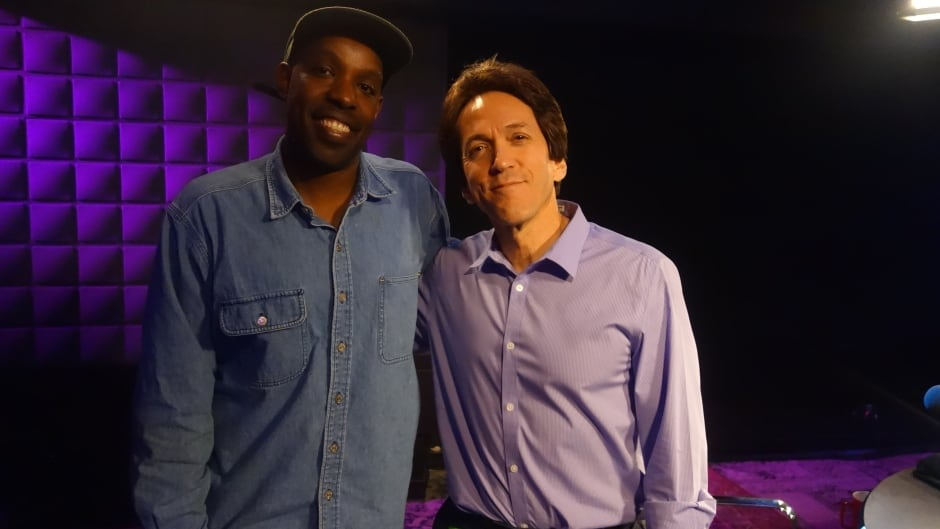 Shad and author Mitch Albom in Studio q.