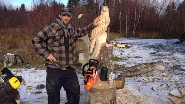 Carver corey chaulk creating art with a chainsaw cbc news