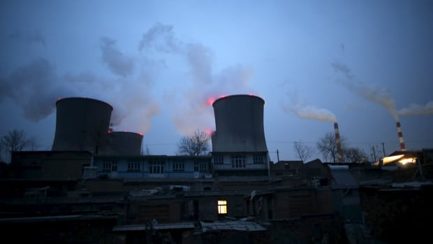 Chimneys of a coal-fired power plant are seen next to residential houses in the night in Shijiazhuang, Hebei province, China, in January. Earlier in November, it came to light that China has been spewing about a billion tonnes more CO2 each year than estimated.