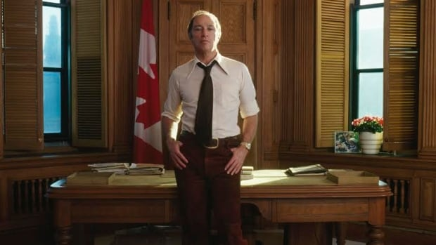 Prime Minister Pierre Trudeau stands in front of his desk on the third floor of Centre Block on Parliament Hill in 1973. The desk has returned to the prime minister's office.