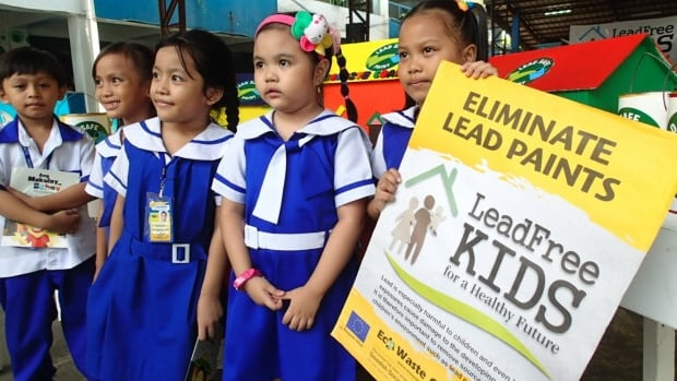 Children at a school in the Philippines mark International Lead Poisoning Prevention Week of Action in October 2015, part of the World Health Organization and United Nations Environment Program's Global Alliance to Eliminate Lead Paint.