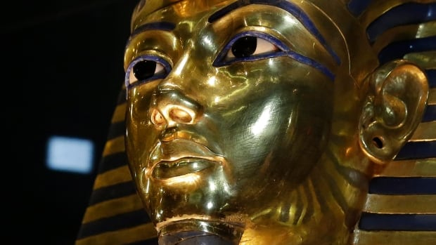 The gold mask of King Tutankhamun is seen in its glass case during a 2015 press tour, in the Egyptian Museum near Tahrir Square in Cairo. Scans of King Tut's burial chamber have revealed two hidden rooms.