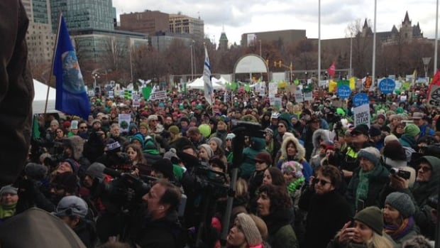 Thousands of people gathered in Ottawa Sunday for the 100% Possible climate march, ahead of the start of climate talks Monday in Paris.