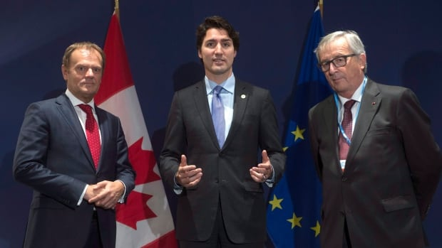 European Council President Donald Tusk, left,  and European Commission President Jean-Claude Juncker, right, met with Prime Minister Justin Trudeau at the UN climate change conference last fall. Juncker announced Tuesday that Canada's trade deal with Europe will proceed towards signature in October as a 'mixed' agreement, with individual countries getting to vote on its eventual ratification.