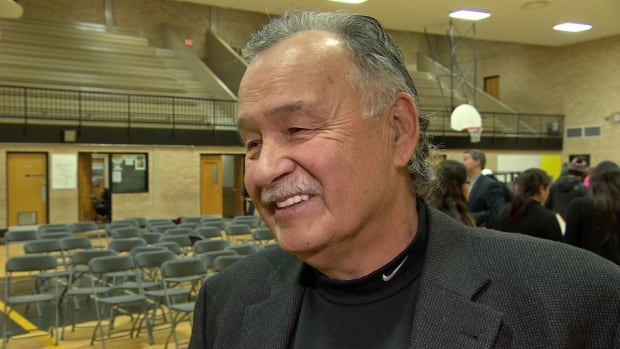 Reggie Leach grins, after speaking to a group of students at Mount Royal Collegiate in Saskatoon.