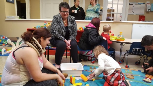 As community services minister, Dartmouth North Liberal candidate Joanne Bernard (seated) started a major transformation process of the department. It remains to be seen if that work will be completed following the election.