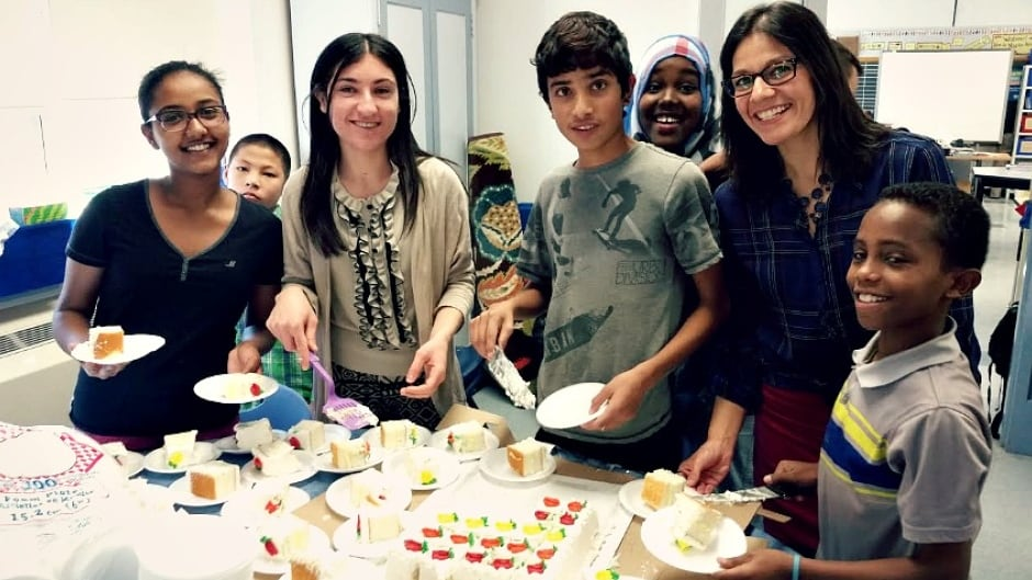 Winnipeg teacher Maranda Obradovic (second from right) from Hugh John Macdonald school in Winnipeg celebrating with kids from the literacy and academic learning centre. Researcher Jan Stewart says Hugh John Macdonald is an excellent example of a school that is doing a good job integrating refugees.
