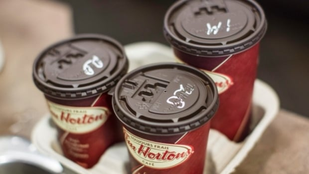 A Tim Hortons drive-thru in Alberta was the scene of an odd texting-and-driving incident. The driver, who received a $287 fine, called it 'ridiculous.' Police say the man was texting with both hands and steering with his knees.