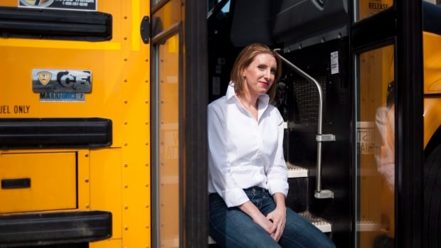 Catherine Carroll, COO and acting CEO of Sober Steering in a school bus that has a steering wheel equipped with the company's biosensors. The sensors can detect if a driver has been drinking.