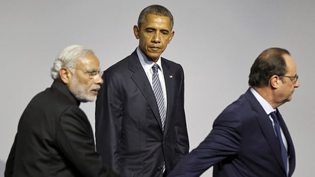 Lead on. U.S. President Barack Obama looks on as French host Francois Hollande leads Indian Prime Minister Narendra Modi off the stage at a clean energy symposium during the COP21 Paris talks.