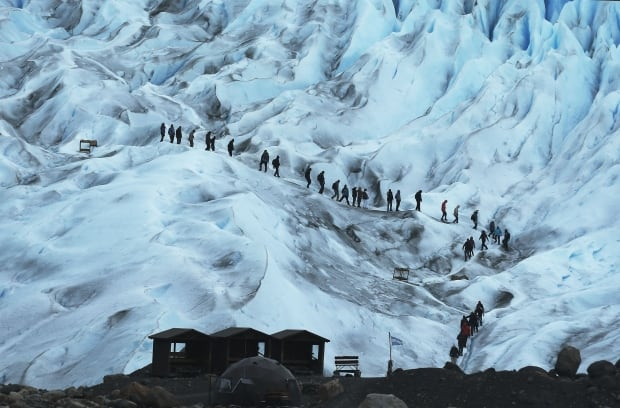 COP21 Argentina hikers on Perito Moreno glacier in Los Glaciares National Park Nov 30 2015