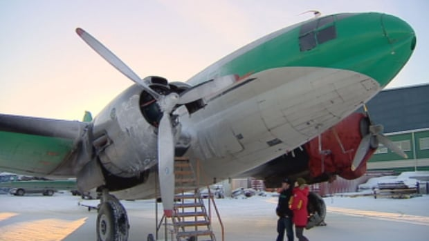 A Buffalo Airways C-46 airplane is shown after it caught fire at the Yellowknife airport in December 2013. Transport Canada grounded the airline in November due to safety compliance issues.