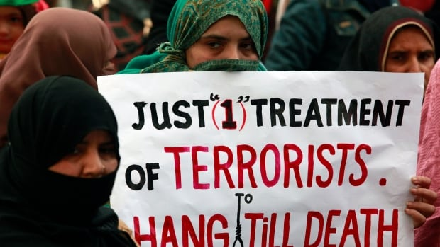 A supporter of political party Pakistan Awami Tehreek is shown on Dec. 21, 2014, in a protest in Lahore to condemn the attack by Taliban gunmen on the Army Public School in Peshawar.