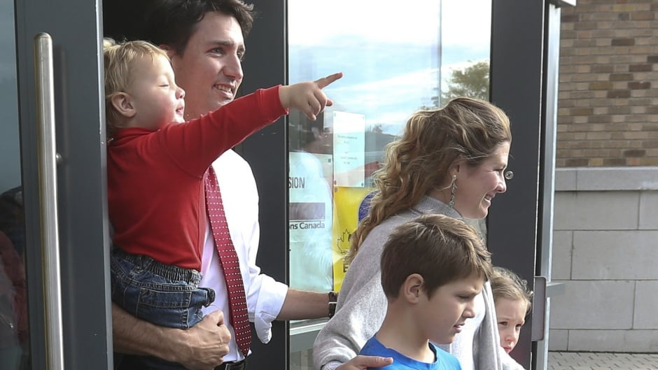 Liberal Leader Justin Trudeau leaves the polling station with his wife Sophie, sons Hadrien, left, Xavier, centre, and daughter Ella-Grace, right, on Oct. 19, 2015.