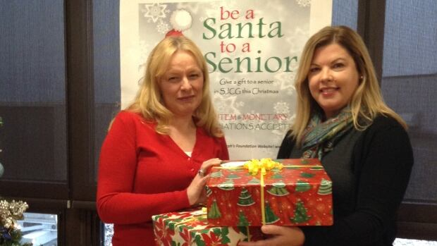 Katrina O'Neill (left), St. Joseph's Foundation executive director , says they're expecting over 300 recipients for their Be Their Secret Santa program this year.