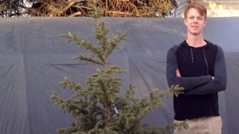 Landon Kennedy Stands Beside One Of His Living Christmas