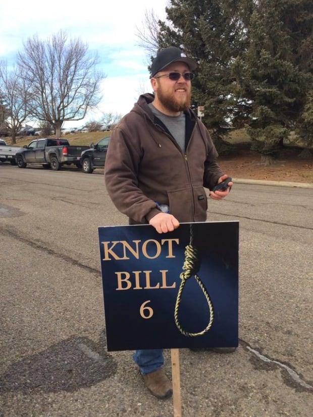 An Alberta farmer attends a Lethbridge Bill 6 protest Thursday