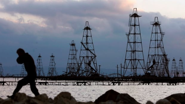 The global oil oversupply will last into next year, the International Energy Agency now says.