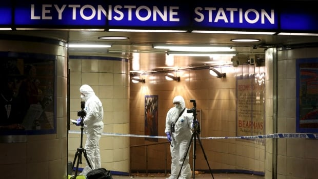 Emergency responders investigate a crime scene at Leytonstone underground station in east London on December 6, 2015. Police were called to reports of a number of people stabbed at the station in east London and a man threatening other people with a knife.