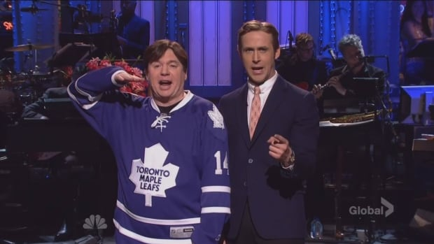 "Ryan Gosling pretends to disown his Canadian roots on SNL's opening monologue while Mike Myers reminds him about ""our hunky new prime minister Trudeau and Sir Justin Bieber."""