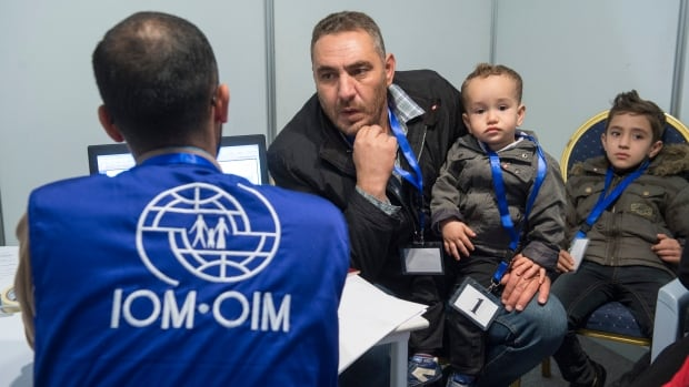 A family of Syrian refugees hoping to be approved for passage to Canada is interviewed at a processing centre in Amman, Jordan on Nov. 29, 2015.
