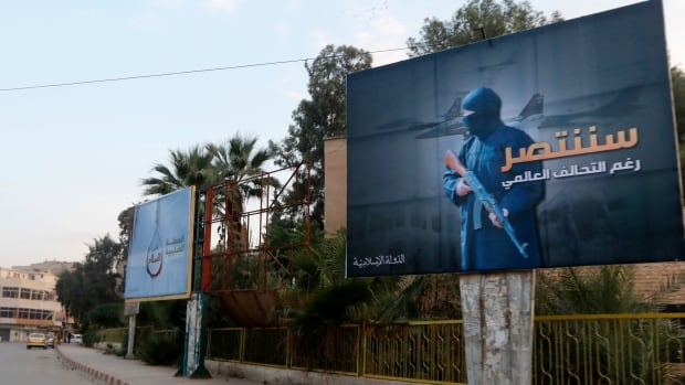 Islamic State billboards are seen along a street in Raqqa, eastern Syria, which is controlled by the Islamic State, on Oct. 29, 2014. The billboard (right) reads:  'We will win despite the global coalition.'