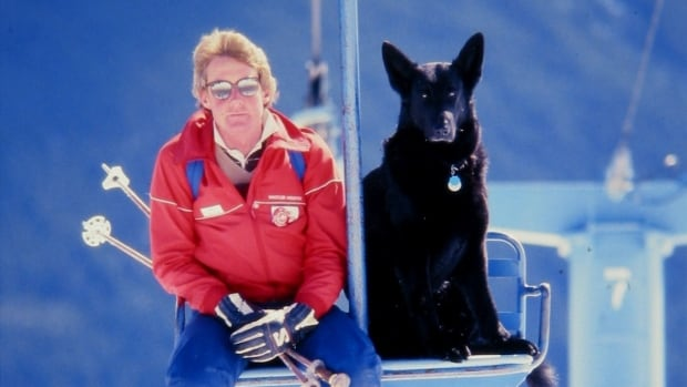 Radar, Whistler's first rescue dog, rides a chairlift with his owner and handler, Bruce Watt in 1979.