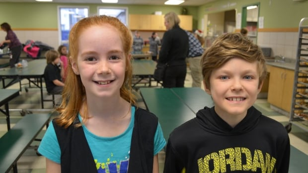 Grade 5 student Melissa Otto and Grade 6 student Jesse Biley are volunteering along with their classmates at Shelter House in Thunder Bay, Ont.