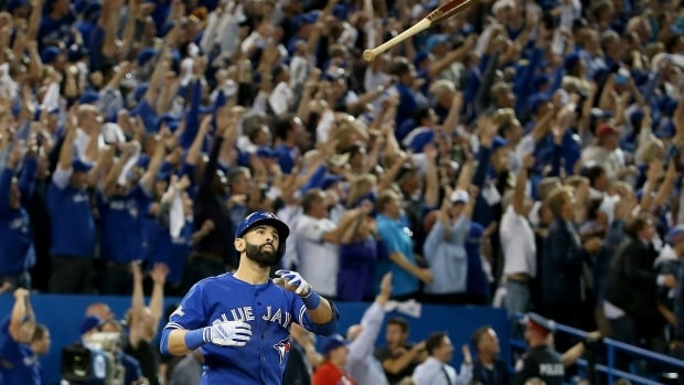 Jose Bautista flips his bat after he hits a three-run home run in the seventh inning in game five of the American League Division Series on October 14, 2015. CBC Toronto is nominated for the Ron Laidlaw Award for continuing social coverage of the Blue Jays' post season run. (Photo by Tom Szczerbowski/Getty Images)