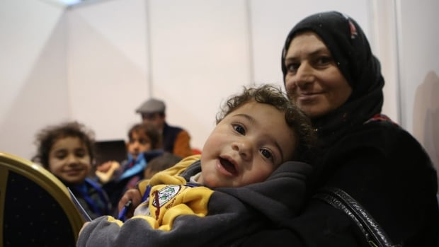 Syrian refugees wait at Marka Airport in Amman, Jordan, on Tuesday, Dec. 8, 2015 to complete their migration procedures to Canada,which has announced that it will take around 25,000 Syrians from Jordan, Lebanon and Turkey.