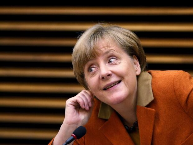 https://i.cbc.ca/1.3357148.1449677035!/fileImage/httpImage/image.jpg_gen/derivatives/4x3_620/merkel-smiles.jpg