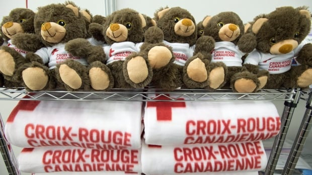 Teddy bears and blankets are seen during a media tour of the arrival facilities for Syrian refugees, in Montreal.