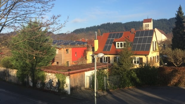 Solar panels are a common sight on residential roofs in Freiburg. Homeowners who help provide power to the electricity grid receive a feed-in tariff from utility companies.