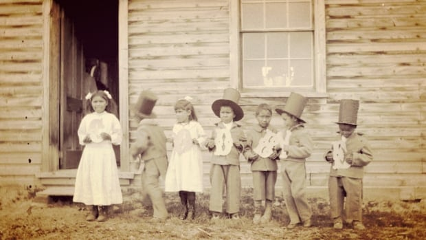 Children hold letters that spell 'goodbye' at Fort Simpson Indian Residential School, in Fort Simpson, N.W.T. in a 1922 archive photo. A recent decision by a B.C. Supreme Court judge means residential school survivors whose claims were rejected by the tribunal tasked with evaluating those claims cannot now see their claims reopened, even with new evidence.