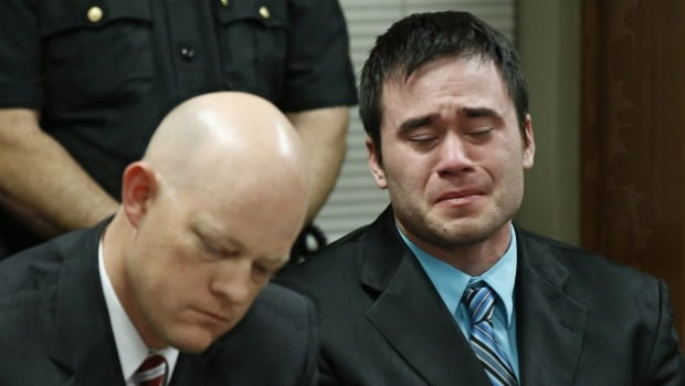 Daniel Holtzclaw, right, cries as the verdicts are read in his trial in Oklahoma City. He was found guilty on 18 of 36 counts, including four rape charges.