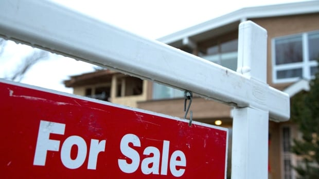 A house for sale in Calgary. The Canada Mortgage and Housing Corporation says there is 'strong evidence' of problematic conditions in the city's real-estate market.
