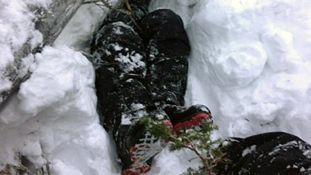 A rescuer snapped this photo of Trevor Hamre's legs and boots as he was being dug out the snow hole he had been trapped in for five hours.