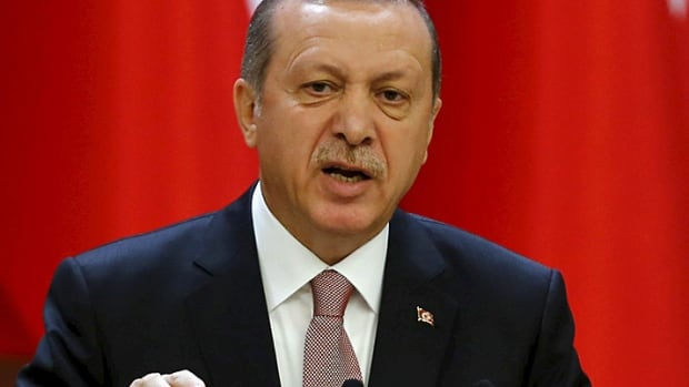 Turkish President Tayyip Erdogan, pictured here speaking at the Presidential Palace in Ankara, Turkey, on  November 26, 2015, criticized Russia on Tuesday for backing Syrian President Bashar Assad, whom he accused of killing hundreds of thousands of people.