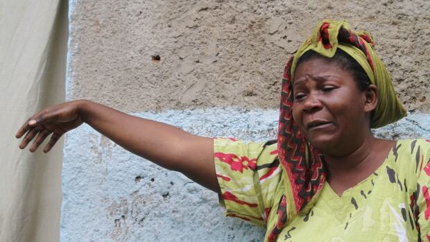 A woman mourns after her son was killed during gunfire in the Nyakabiga neighbourhood of Burundi's capital Bujumbura.