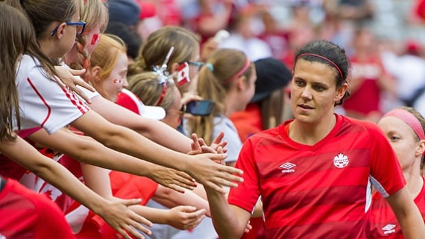 Christine Sinclair, right, has 157 career goals and can move into a tie with retired U.S. star Mia Hamm for second on the all-time list in Canada's match against Trinidad and Tobago on Sunday.