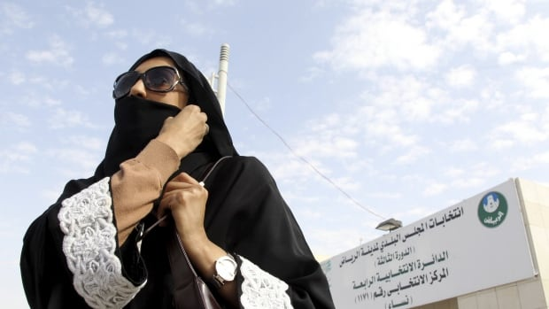 A Saudi woman leaves a polling station after casting her vote during municipal elections in Riyadh on Saturday.