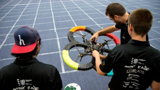 Élikos team members check their drone before a run at the International Aerial Robotics Competition in Atlanta in August.