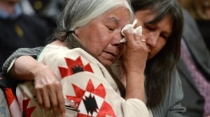 Residential school survivor Lorna Standingready is comforted by a fellow survivor during the closing ceremony of the Truth and Reconciliation Commission, at Rideau Hall in Ottawa on June 3, 2015.
