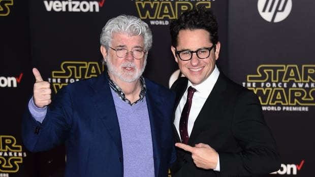 The Force Awakens director J.J. Abrams, seen at right with Star Wars creator George Lucas, is returning to write and direct the forthcoming Episode IX, Lucasfilm has announced.