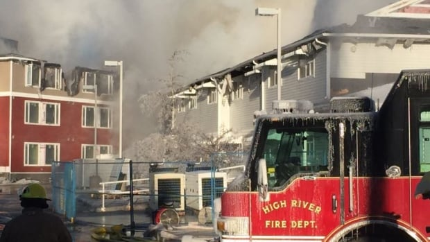 Fire crews worked late into Tuesday morning to battle a fire that destroyed a seniors facility in High River.