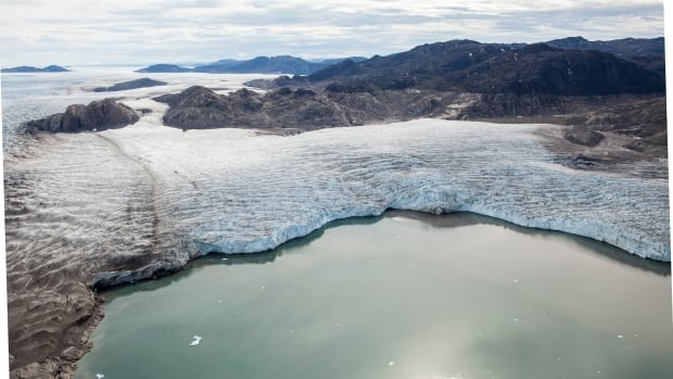 The Upernavik Glacier in northwest Greenland is melting into a lake. Greenland's ice sheet has been melting twice as fast during the 21st century as it did during the 20th.