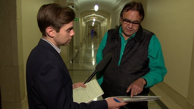 Aboriginal and Northern Affairs Minister Eric Robinson, right, told CBC's Chris Glover in December that he was 'disappointed and troubled' by allegations that he had promised work on Manitoba Hydro's Bipole III project in exchange for a northern chief's support for Premier Greg Selinger.