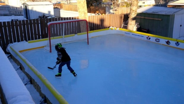This backyard rink in Fort McMurray, Alta., called Luke's Rink, was the first rink in Canada submitted to the RinkWatch website for the 2015-16 winter. The site compiles citizen-submitted backyard rink data to monitor weather conditions and track the number of skateable days.